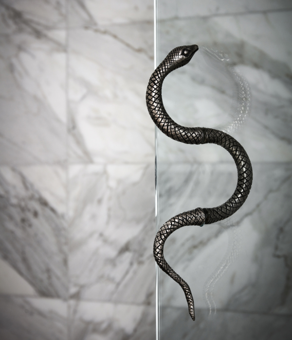 Artistic snake handle on glass shower door in hotel suites at Maison de la Luz; unique hotels, top hotels in New Orleans  Fixtures