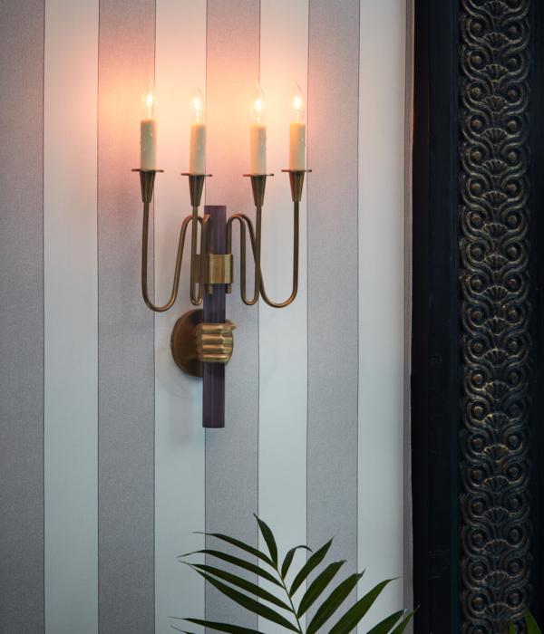 Luxury amenities: an artistic hand-held candle chandelier at Maison de la Luz, boutique hotels French Quarter
