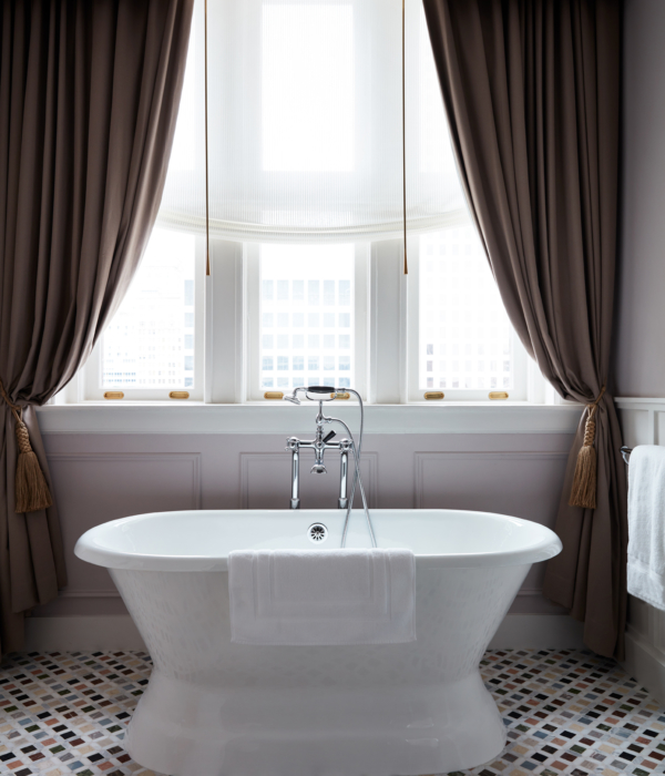 Luxurious hotel bathroom at Maison de la Luz, fit for a New Orleans getaway; romantic ambiance and luxury accommodation